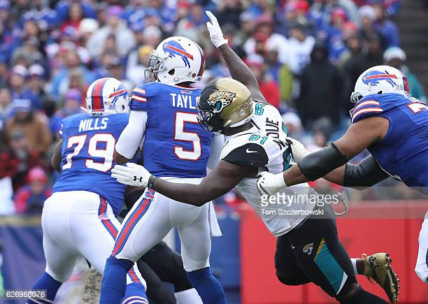 Tyrod Taylor of the Buffalo Bills is sacked by Yannick Ngakoue of the Jacksonville Jaguars during NFL game action at New Era Field on November 26...