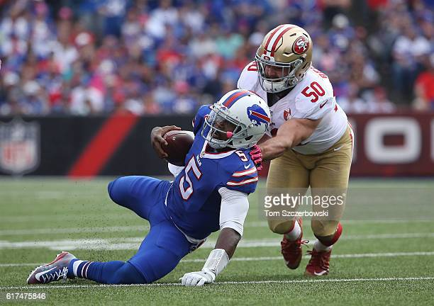 Tyrod Taylor of the Buffalo Bills is tackled by Nick Bellore of the San Francisco 49ers during NFL game action at New Era Field on October 16, 2016...