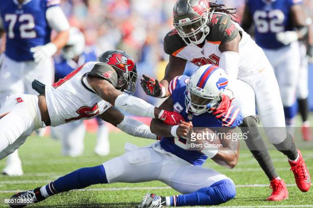 Tyrod Taylor of the Buffalo Bills is tackled by TJ Ward of the Tampa Bay Buccaneers and Will Clarke of the Tampa Bay Buccaneers during the second...