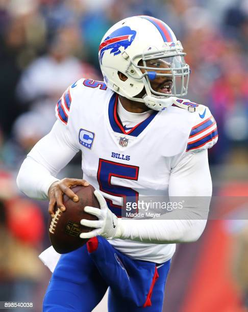 Tyrod Taylor of the Buffalo Bills looks for a pass during the first half against the New England Patriots at Gillette Stadium on December 24 2017 in...