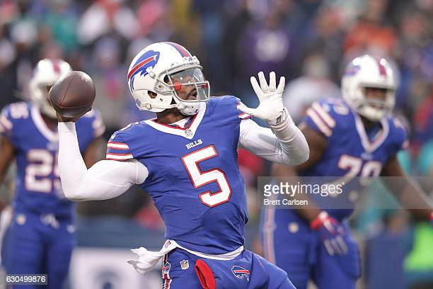 Tyrod Taylor of the Buffalo Bills looks throw against the Miami Dolphins during the first half at New Era Stadium on December 24 2016 in Orchard Park...