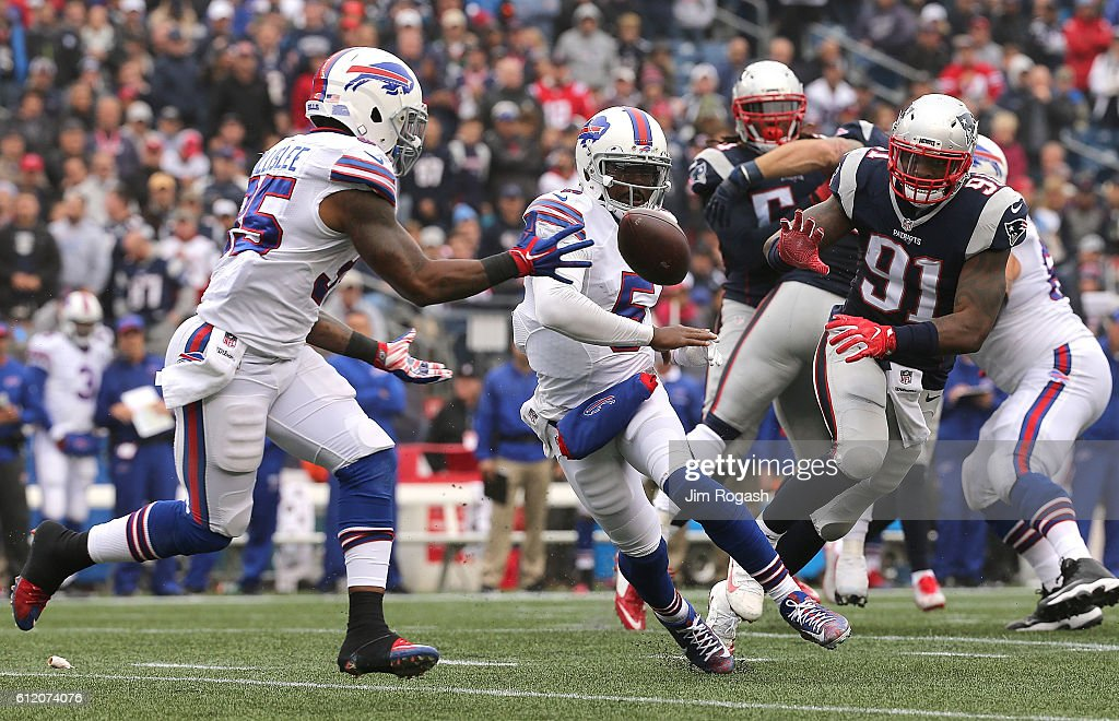 Tyrod Taylor #5 of the Buffalo Bills pitches the ball to Mike Gillislee #35 of the Buffalo Bills in the second half at Gillette Stadium on October 2, 2016 in Foxboro, Massachusetts.