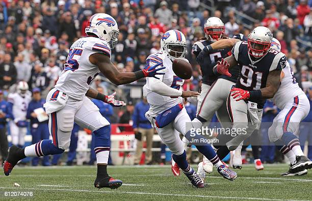 Tyrod Taylor of the Buffalo Bills pitches the ball to Mike Gillislee of the Buffalo Bills in the second half at Gillette Stadium on October 2, 2016...