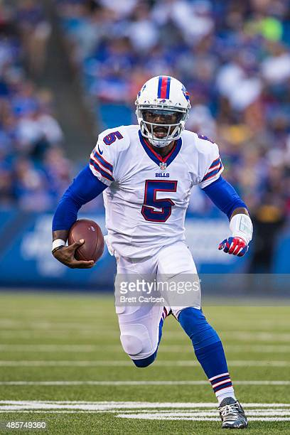 Tyrod Taylor of the Buffalo Bills runs the ball on a quarterback keeper against the Carolina Panthers on August 14 2015 during a preseason game at...