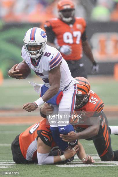 Tyrod Taylor of the Buffalo Bills runs the football up field against Vontaze Burfict of the Cincinnati Bengals during their game at Paul Brown...