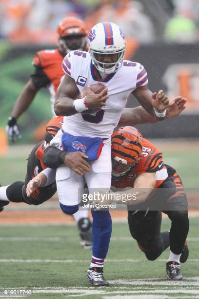 Tyrod Taylor of the Buffalo Bills runs the football up field against Nick Vigil of the Cincinnati Bengals during their game at Paul Brown Stadium on...