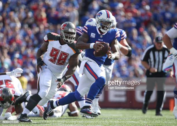 Tyrod Taylor of the Buffalo Bills runs with the ball during NFL game action as he is pursued by Clinton McDonald of the Tampa Bay Buccaneers at New...