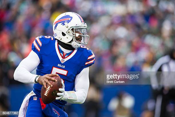 Tyrod Taylor of the Buffalo Bills scrambles with the ball during the game against the New York Jets on January 3 2016 at Ralph Wilson Stadium in...
