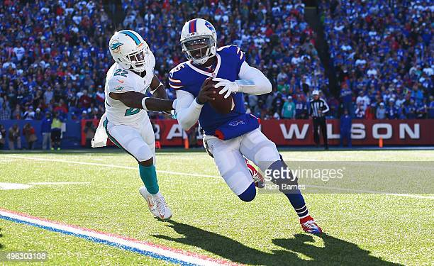 Tyrod Taylor of the Buffalo Bills turns the corner past Jamar Taylor of the Miami Dolphins during the first half at Ralph Wilson Stadium on November...
