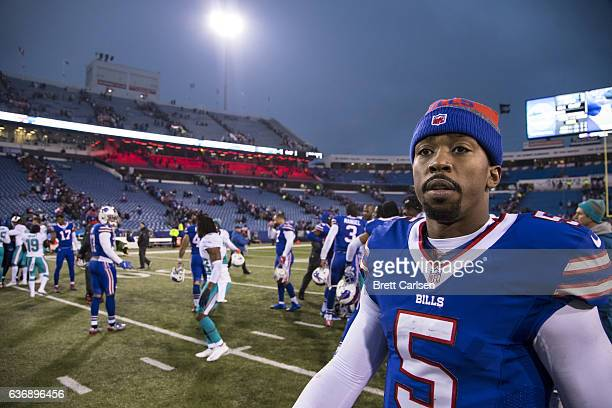 Tyrod Taylor of the Buffalo Bills walks off the field after the game against the Miami Dolphins on December 24 2016 at New Era Field in Orchard Park...