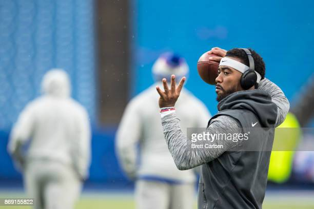 Tyrod Taylor of the Buffalo Bills warms up before the game against the Oakland Raiders at New Era Field on October 29 2017 in Orchard Park New York...