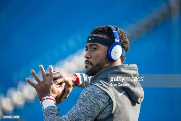 Tyrod Taylor of the Buffalo Bills warms up before the game against the New England Patriots at New Era Field on December 3 2017 in Orchard Park New...