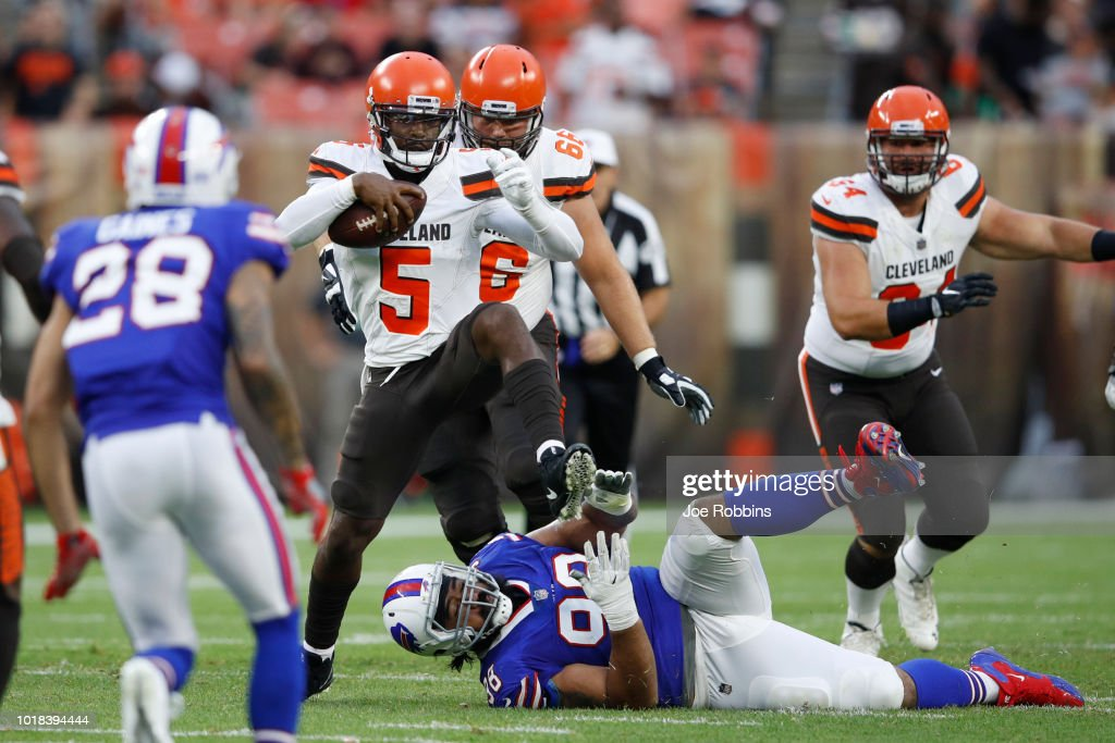 Tyrod Taylor #5 of the Cleveland Browns breaks a tackle while pursued by Star Lotulelei #98 of the Buffalo Bills in the first quarter of a preseason game at FirstEnergy Stadium on August 17, 2018 in Cleveland, Ohio.