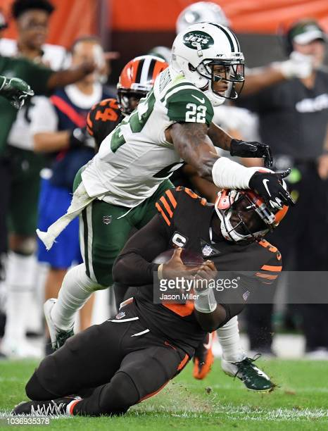 Tyrod Taylor of the Cleveland Browns gets hit while sliding by Trumaine Johnson of the New York Jets during the second quarterat FirstEnergy Stadium...