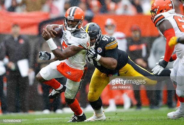 Tyrod Taylor of the Cleveland Browns is dragged down by Cameron Heyward of the Pittsburgh Steelers during the second quarter at FirstEnergy Stadium...