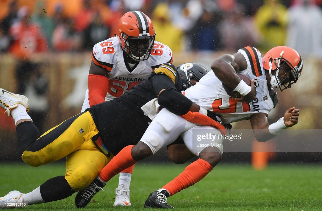 Tyrod Taylor #5 of the Cleveland Browns is tackled by Cameron Heyward #97 of the Pittsburgh Steelers during the second quarter at FirstEnergy Stadium on September 9, 2018 in Cleveland, Ohio.