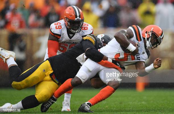 Tyrod Taylor of the Cleveland Browns is tackled by Cameron Heyward of the Pittsburgh Steelers during the second quarter at FirstEnergy Stadium on...