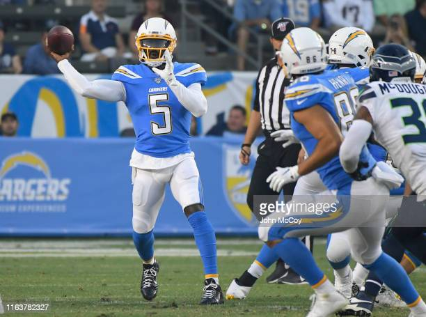 Tyrod Taylor of the Los Angeles Chargers throws a short pass against the Seattle Seahawks in the first quaarter during a pre-season NFL football game...