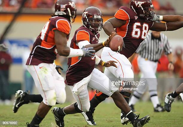 Tyrod Taylor of the Virginia Tech Hokies tosses the ball to Ryan Williams during the game against the Nebraska Cornhuskers at Lane Stadium on...