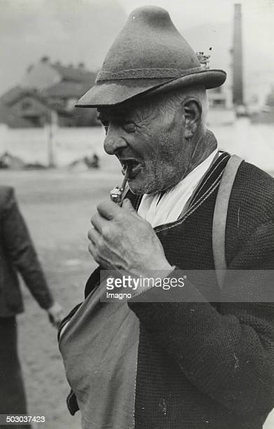 Tyrolean farmer with whistle About 1935 Photograph by Simon Moser