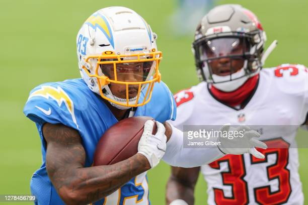 Tyron Johnson of the Los Angeles Chargers catches a pass for a touchdown during the first quarter of a game against the Tampa Bay Buccaneers at...