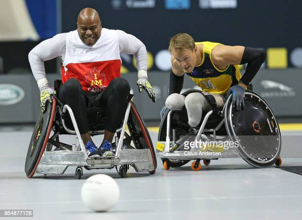 Tyron Lincoln of Team Canada chases after a loose ball against Curtis McGrath of Team Australia in action on Day Five at Wheelchair Rugby during the...