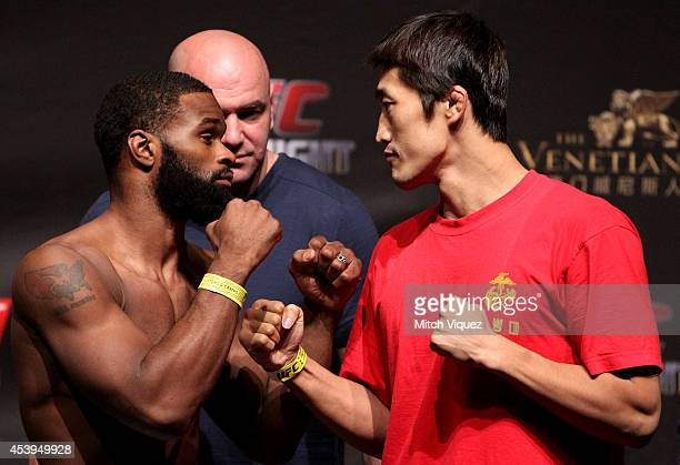 Tyron Woodley and Dong Hyun Kim during the UFC weigh-in event at the Venetian Macau on August 22, 2014 in Macau, Macau..