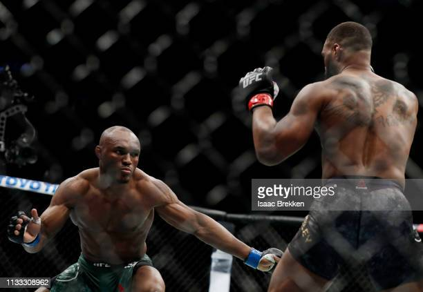 Tyron Woodley and Kamaru Usman of Nigeria fight during their welterweight title bout during UFC 235 at TMobile Arena on March 02 2019 in Las Vegas...