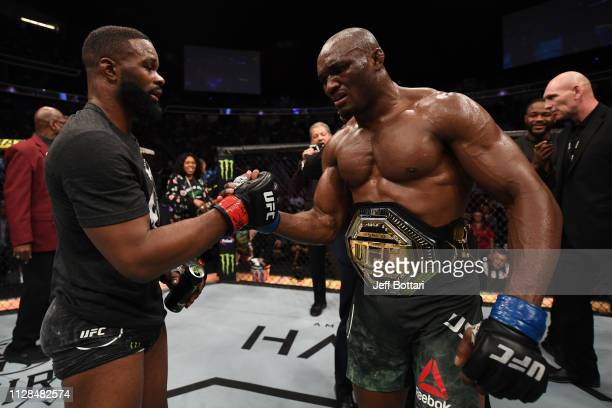 Tyron Woodley and Kamaru Usman of Nigeria pay respects after their UFC welterweight championship bout during the UFC 235 event at TMobile Arena on...