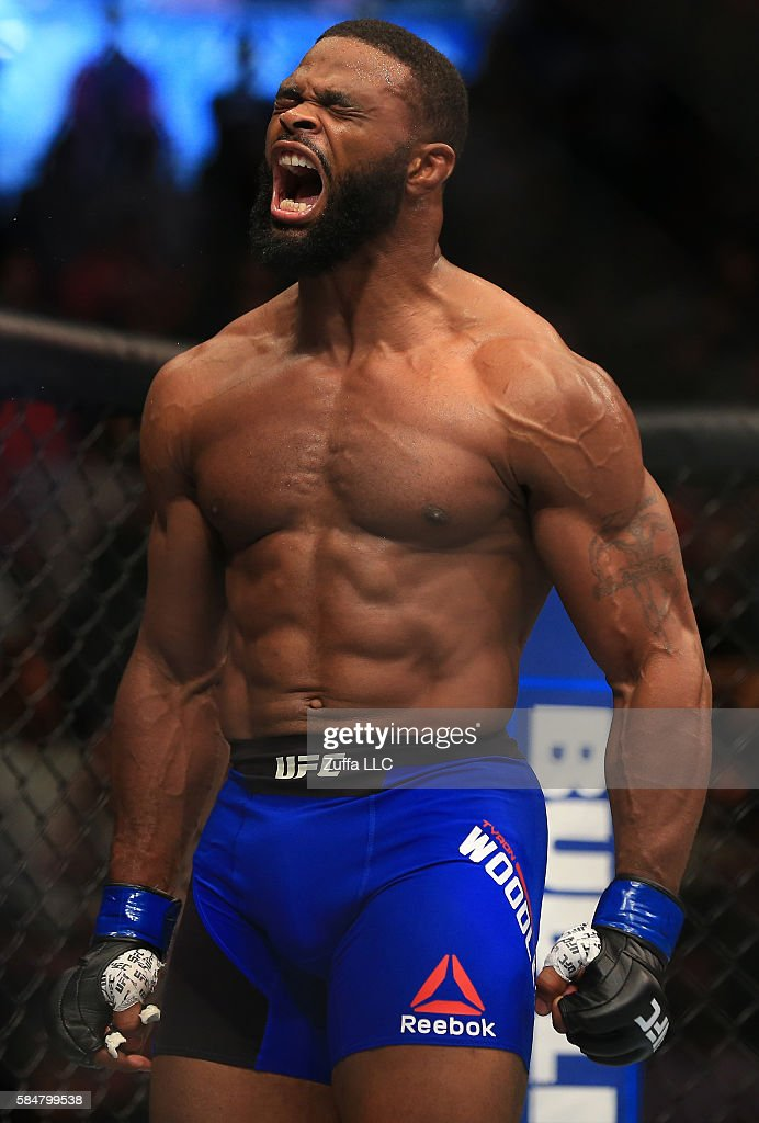 Tyron Woodley celebrates after his knockout victory over Robbie Lawler in their welterweight championship bout during the UFC 201 event on July 30, 2016 at Philips Arena in Atlanta, Georgia.