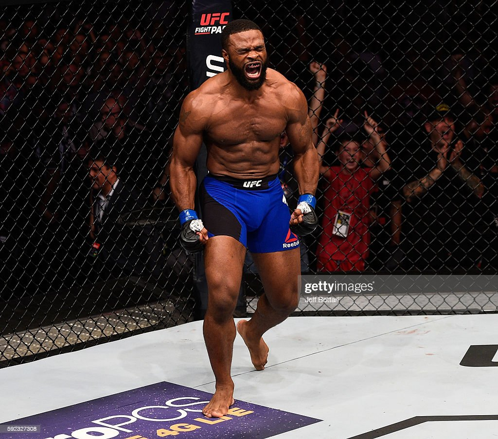 Tyron Woodley celebrates after knocking out Robbie Lawler in their welterweight championship bout during the UFC 201 event on July 30, 2016 at Philips Arena in Atlanta, Georgia.