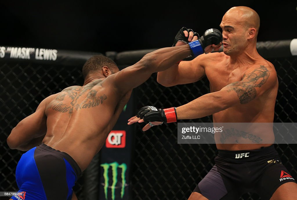 Tyron Woodley delivers a right hand to knock down opponent Robbie Lawler in their welterweight championship bout during the UFC 201 event on July 30, 2016 at Philips Arena in Atlanta, Georgia.
