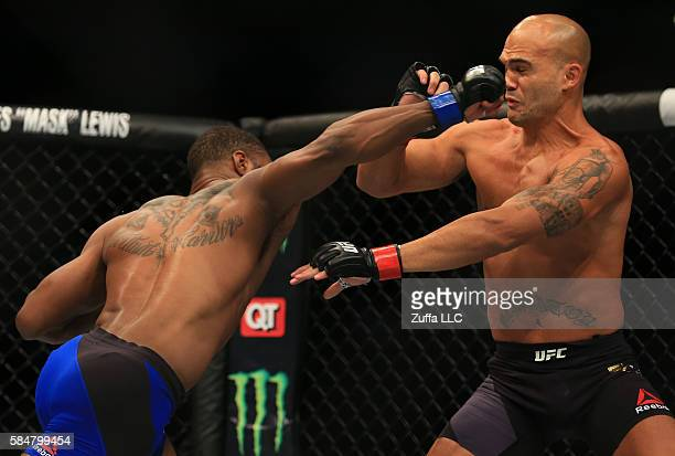 Tyron Woodley delivers a right hand to knock down opponent Robbie Lawler in their welterweight championship bout during the UFC 201 event on July 30...