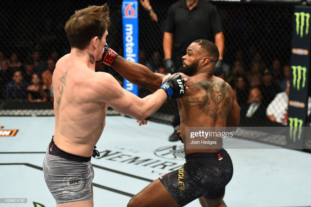 Tyron Woodley punches Darren Till of England in their UFC welterweight championship fight during the UFC 228 event at American Airlines Center on September 8, 2018 in Dallas, Texas.