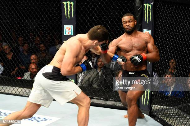 Tyron Woodley punches Demian Maia of Brazil in their UFC welterweight championship bout during the UFC 214 event at Honda Center on July 29 2017 in...