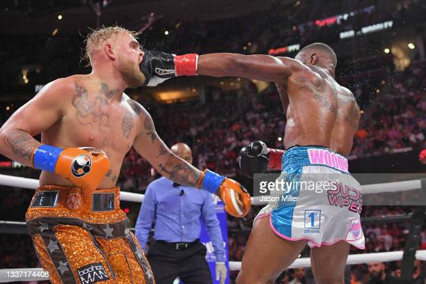 Tyron Woodley punches Jake Paul in their cruiserweight bout during a Showtime pay-per-view event at Rocket Morgage Fieldhouse on August 29, 2021 in...