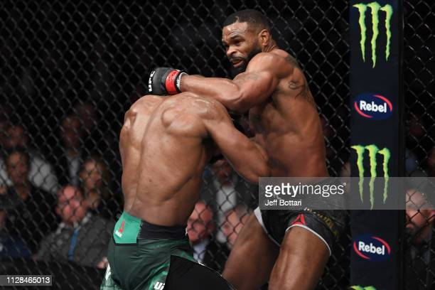 Tyron Woodley punches Kamaru Usman of Nigeria in their UFC welterweight championship bout during the UFC 235 event at TMobile Arena on March 2 2019...