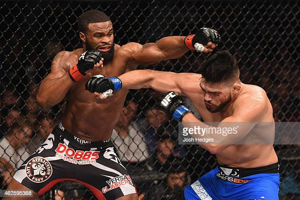 Tyron Woodley punches Kelvin Gastelum in their welterweight bout during the UFC 183 event at the MGM Grand Garden Arena on January 31 2015 in Las...