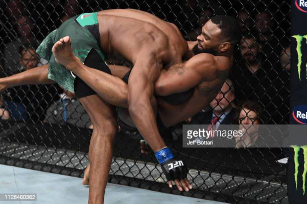 Tyron Woodley takes down Kamaru Usman of Nigeria in their UFC welterweight championship bout during the UFC 235 event at TMobile Arena on March 2...