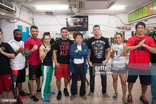 Tyron Wooldy Alberto Mina Milana Dudieva Cung Le Master Sam Lau Michael Bisping Elizabeth Phillips and Dong Hyun Kim pose for photos during a UFC...