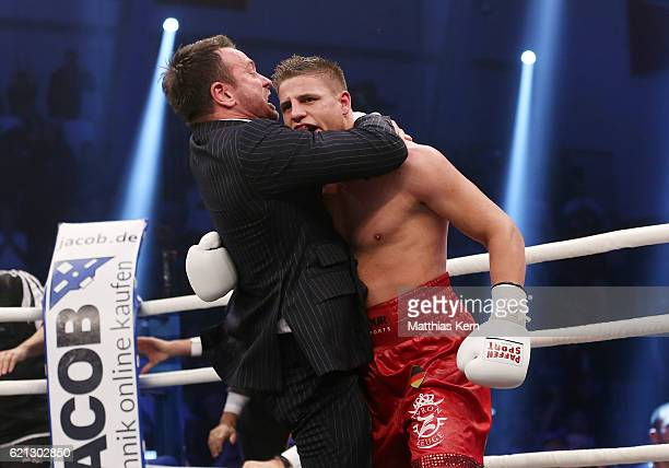 Tyron Zeuge of Germany and Kalle Sauerland show their delight after winning the WBA Super Middleweight World Championship title fight between Tyron...