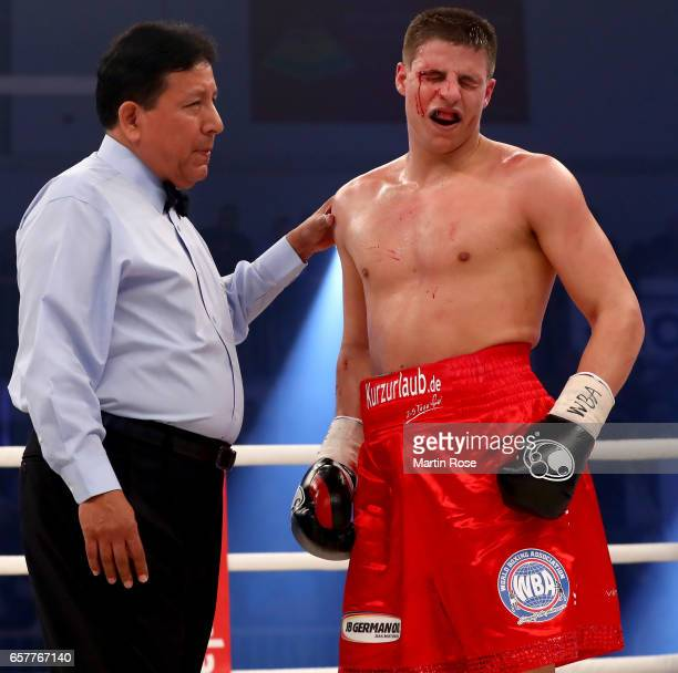 Tyron Zeuge of Germany bleeds during their WBA super middleweight championship title fight at MBS Arena on March 25 2017 in Potsdam Germany