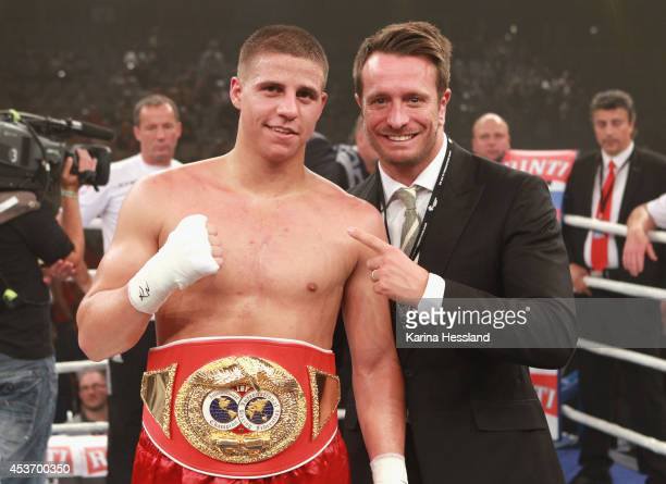 Tyron Zeuge of Germany poses with boxing promoter Kalle Sauerland after winning the IBF International Super Middleweight Championship title fight...