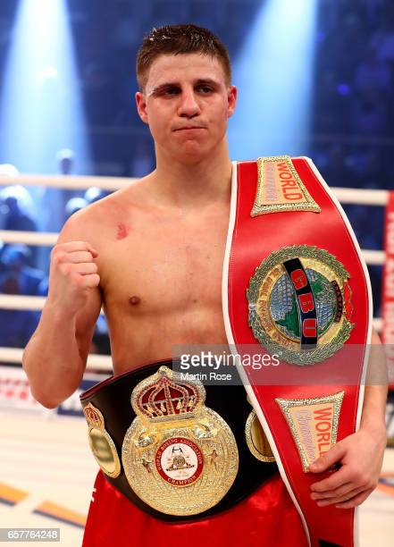 Tyron Zeuge of Germany poses with the trophys afer their WBA super middleweight championship title fight at MBS Arena on March 25 2017 in Potsdam...