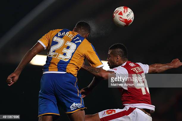 Tyrone Barnett of Shrewsbury Town and Dionatan Teixeira of Fleetwood Town during the Johnstone's Paint Trophy Second Round match between Fleetwood...