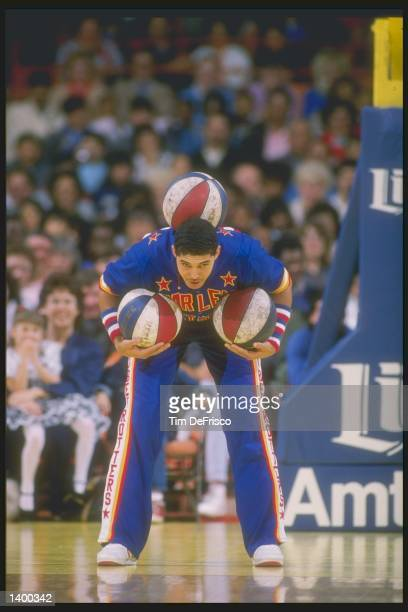 Tyrone Brown of the Harlem Globetrotters does some tricks during a game Mandatory Credit Tim de Frisco /Allsport