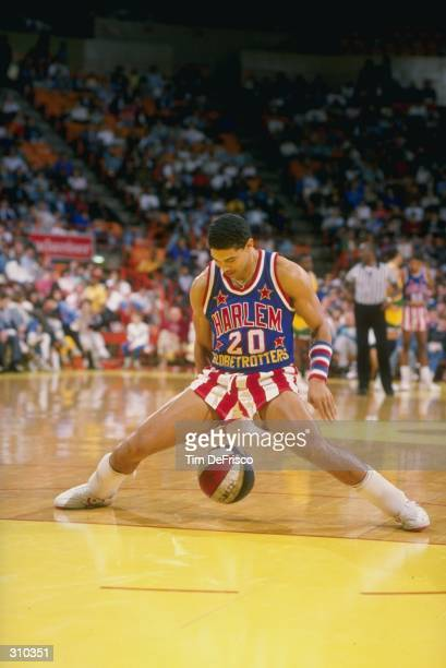 Tyrone Brown of the Harlem Globetrotters dribbles the ball down the court during a game Mandatory Credit Tim de Frisco /Allsport