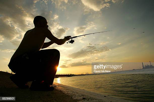 Tyrone Burchett casts his fishing line into the California Aqueduct which carries water hundreds of miles from northern California to the state's...