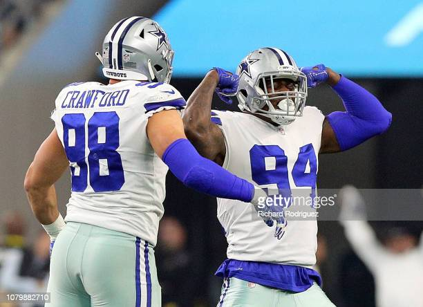 Tyrone Crawford of the Dallas Cowboys and Randy Gregory of the Dallas Cowboys celebrate a first quarter sack of Carson Wentz of the Philadelphia...