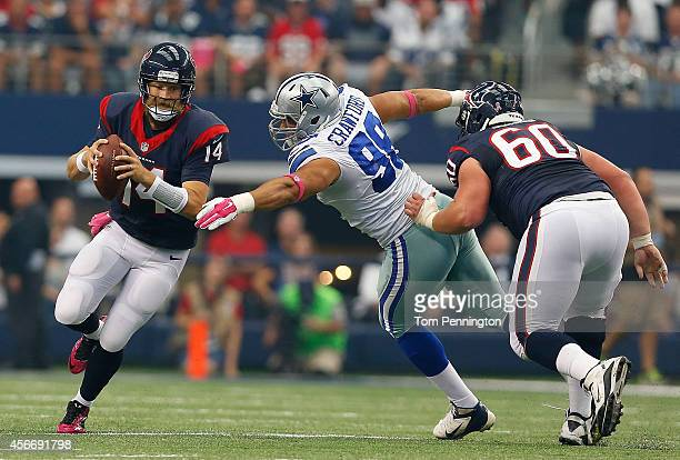 Tyrone Crawford of the Dallas Cowboys chases Ryan Fitzpatrick of the Houston Texans from the pocket as Ben Jones of the Houston Texans blocks in the...